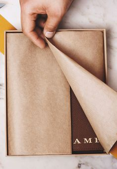 Gift-wrapped and monogrammed with embossed lettering, discover our selection of Burberry leather notebooks.