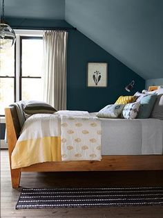 Have you ever considered painting the room all one color? It's an amazing look. In fact, with sloping ceilings especially, I love to use one color everywhere, like in this charming attic room that would be perfect for a boy or a guest room.