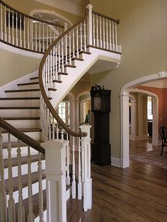 Gorgeous Curved Staircase In Foyer - Plan #129S-0008 | houseplansandmore.com