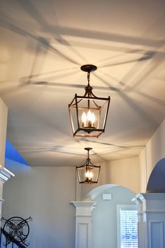 Sometimes lighting can make all the difference. When we moved into our new home, all of our hallways consisted of your basic flush mount dome lights #lighting #farmhouselights #lanterns