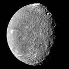 "The most curious feature of Umbriel is the bright ring on top of the moon, referred to as ""the fluorescent cheerio"", created from a hit of a crater. Umbriel is a really dark moon, only reflecting half the light as Ariel does."