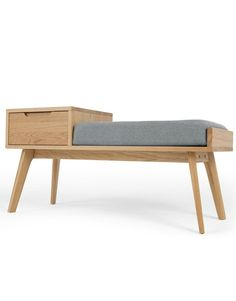 Jenson bench with storage oak. Clean lines, subtle curves, boomerang-shaped legs and a light gray seat make this bench a real eye-catcher in the hallway or in an unloved corner.