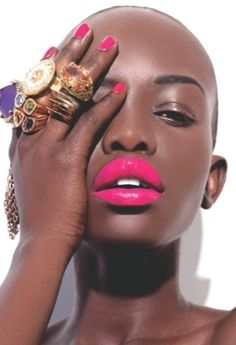Bald women with bright lipstick & unique rings