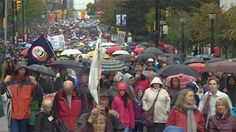 Thousands of people braved a pouring rain in Vancouver Sunday, Sept 22/13 to take part in a reconciliation walk marking the sad history of residential schools in Canada, erupting in a raucous cheer as the daughter of American civil rights hero Martin Luther King Jr. urged all Canadians to move forward and heal.
