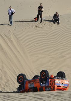 Dakar Rally 2013 in photos .....I can only hope they are watching the driver and nav digging their way out.