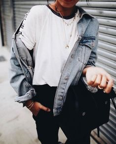 Denim jacket over white tee and black jeans.