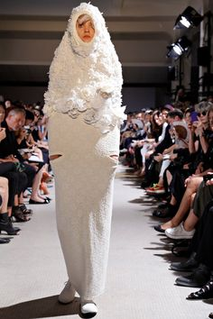 Comme Des Garcons..A giant condom. Nice Look.  For god sake give the money to Oxfam and stop wasting it on this crap.