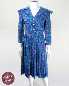This wearable original #40s #vintage #dress is in a gorgeous blue and purple palette. Modern UK size 10.   A beautiful original #1940s vintage day dress in stunning palette of ... #retro #clothing #women #florals #roses