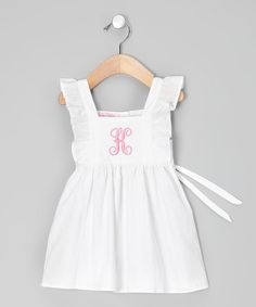 This crisp white dress is decorated with an eye-catching embroidered initial. Fluttery angel sleeves and a back sash add an extra charming touch.Personalize with initial100% cottonMachine wash; hang dryImported