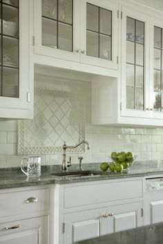 A clean, modern, white kitchen designed by Mark P. Finlay