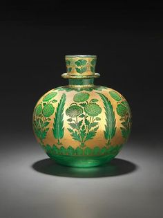 Huqqa (water pipe) of emerald-green glass decorated with gold and yellow enamel  Northern India; 1st half of 18th century