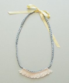Lucille Barbe Necklace, Yellow (http://www.shopminikin.com/lucille-barbe-necklace-yellow/)