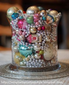 Very Merry Vintage Syle: Make a Christmas Centerpiece with Vintage Ornaments  -- LOVE adding the string of beads to the vase...can add that to my vase of ornaments next year!