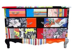 by Squint Limited! OMG, is this not the coolest thing. wrapped using fabrics of silks, velvets and prints.