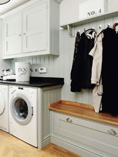 utility room with coat hook for wet coats and bench storage with lift up top rather than drawer for laundry, shelf above