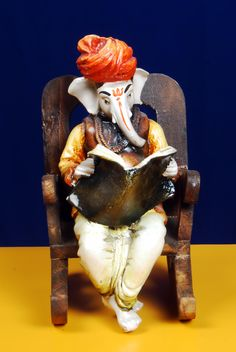 Ganesha | Ganesha Reading News Paper on a Wooden Chair Best Price