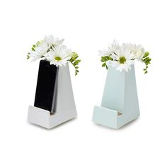 "BEDSIDE SMARTPHONE VASE | iphone vase, dock | UncommonGoods.com Part smartphone dock, part vase Charge phone using your own power cord threaded through the convenient opening. handmade in Pittsburgh 4"" L x 3"" W x 6"" H. #26523 White or Mint $32"