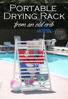 Drying Rack From An Old Crib Rail.  What a great way to use an old dropside crib.  It folds up and stores out of the way.. perfect for drying towels next to the pool!