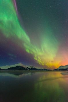 Aurora borealis over Turnagain Arm in Chugach National Forest, Alaska.