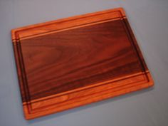 Our Expression Series Cutting Boards showcase distinctive character that only nature can provide. This example is made from what many refer to as one of the most beautiful woods, Black Walnut with Che