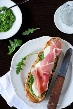 Bruschetta with Mozzarella, Prosciutto and Arugula Pesto... The best part is I currently have all of the ingredients for this.