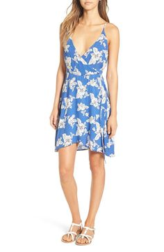 Loving this summery blue and white floral patterned dress. It features swingy ties, a surplice bodice, and front and back plunging necklines.