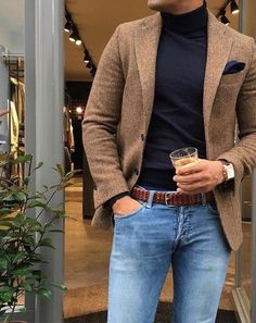 Buy the look on Lookastic: lookastic.fr / … – Brown wool blazer – Navy clutch bag – Black turtleneck sweater – Brown braided leather belt – Light blue jeans by Fashion Night, Sport Fashion, Look Fashion, Fashion Suits, Fashion Men, Fashion Ideas, Fashion Clothes, Style Clothes, Mens Smart Casual Fashion