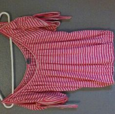 Cute pink and white blouse I don't know what brand it is, the tag was ripped out before it was mine. Very nice summer shirt, I've only worn it a handful of times. The side tag says size small and made in China. Tops Blouses