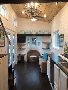 I love that little nook with the window and the shelving. Great use of space (though you could add more shelves or cabinets above if needed).