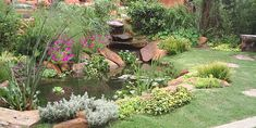 Exterior garden made with flowers, grass and a little lake.