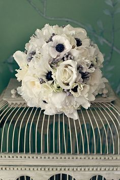 Primarily white bouquet with touches of dark blue and silver