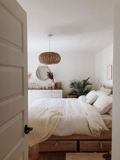 so in love with the organic simplicity that white linen bedding can bring to a space. A wonderfully calming bedroom by We're so in love with the organic simplicity that white linen bedding can bring to a space. A wonderfully calming bedroom by  Home Decor Bedroom, Modern Bedroom, Bedroom Ideas, Bedroom Inspo, Calm Bedroom, White Bedrooms, Bedroom Furniture, Dream Bedroom, Mirror In Bedroom