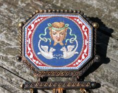 Antique Micro-Mosaic Pin.  In a mythological theme this pin was created by a master craftsman.  I have never felt a micro-mosaic so smooth to the touch.  A true artist created and laid these tiny glass pieces.
