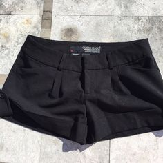{Guess Shorts} Simple black Guess shorts. Super sexy fit. Pre loved but in good condition. Guess Shorts