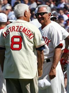 Former star Carl Yastrzemski, one of 200 former Red Sox players, managers and coaches at Fenway Park on Friday, visits manager Bobby Valentine in pregame ceremonies.