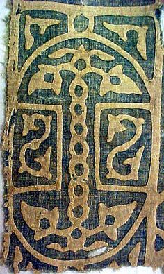 Tiraz textile fragment probably manufactured in Egypt and dating to the Mamluk Caliphate (ca. AD 1400). White applique on a blue ground. Specimen 73.576 in the collection of the Textile Museum, Washington DC.