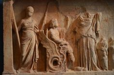 Votive relief depicting Triptolemus enthroned ready to embark on the mission* set to him by Demeter- the figure before him. The woman holding the torches is Persephone. Behind Demeter are depicted the adorants. (early century B. Athens Acropolis, Daughter Of Zeus, Epic Of Gilgamesh, Greek And Roman Mythology, The Empress, Persephone, Torches, Childish Gambino, Artist