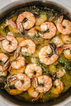 This easy olive oil poached shrimp recipe is perfect for a healthy weeknight dinner or lite lunch. Sounds fancy and hard, but is super easy and takes 5 minutes to poach the most buttery shrimp you will ever have!