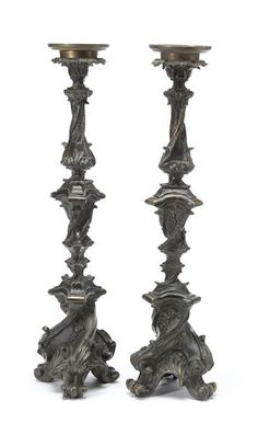 A pair of Baroque style patinated bronze candle torchères,19th century.