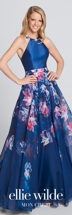 Long chiffon open back prom dress. Sleeveless A-line gown with Mikado halter bodice, multiple back straps, printed charmeuse and chiffon skirt.