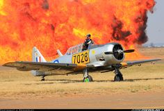 North American Harvard IIA ZU-AOP / 7028 (cn The nonchalant pilot of 7028 acting like a giant wall of flames is no big deal. Taken at the 2015 SAAF Museum airshow. South African Air Force, Us Military Aircraft, Impalas, Aircraft Pictures, Africans, Air Show, Harvard, Airplanes, Wwii