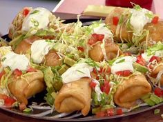 Food Network invites you to try this Top Notch Top Round Chimichangas recipe from Guy Fieri.