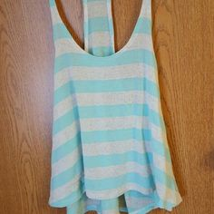 Acemi top Acemi top. Worn but in excellent condition. The front is shorter than the back. Just ask of you need better pictures. I couldn't find a size on this to safe my life. But fits me. I'm a small/medium. Tops Tank Tops