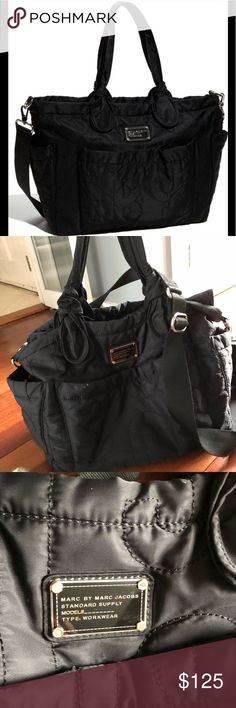 Gently used Eliza-A-Baby Black diaper bag Gently used and in excellent condition Marc by Marc Jacobs Black Nylon Eliz-A-Baby diaper bag.  Small white mark and bit of tarnish on brand tag both on front as seen in picture, the white can probably be wiped off. Marc By Marc Jacobs Bags