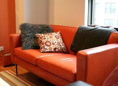 Dale & Adam's Detailed Duplex Orange Couch, Adams Homes, Orange Rooms, Duplex House, Duplex Apartment, Sit Back And Relax, Basement Remodeling, Living Room Sofa, Apartment Therapy