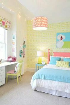 A yellow room for girls with patterned roman blinds