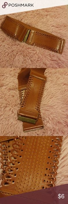 Brown Belt Brown belt in like new condition. Elastic mid section. Please see pics for more detaisl. Size M/L Accessories Belts
