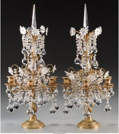 A PAIR OF GILT BRONZE AND GLASS SIX-LIGHT GIRANDOLES, LATE 19TH CENTURY 26 INCHE