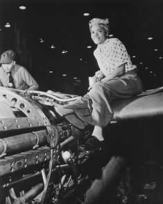 An African-American riveter at work at the Lockheed plant, 1940-1945 — in Burbank, California.