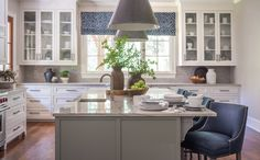Nandina Home And Design Atlanta Aiken Kitchen Columbia  -white kitchen with white marble island, blue bar stools and drum pendant lighting